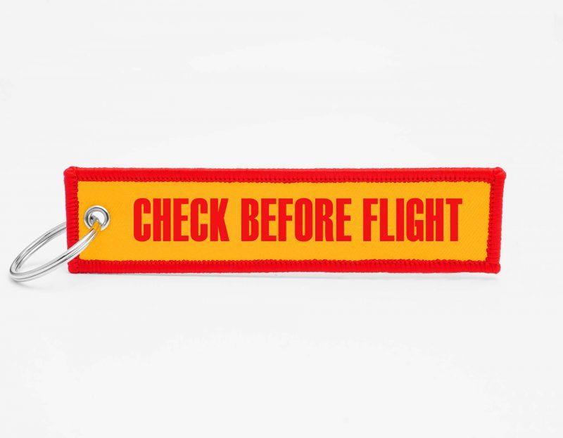 check before flight Schluesselanhaenger mit logo