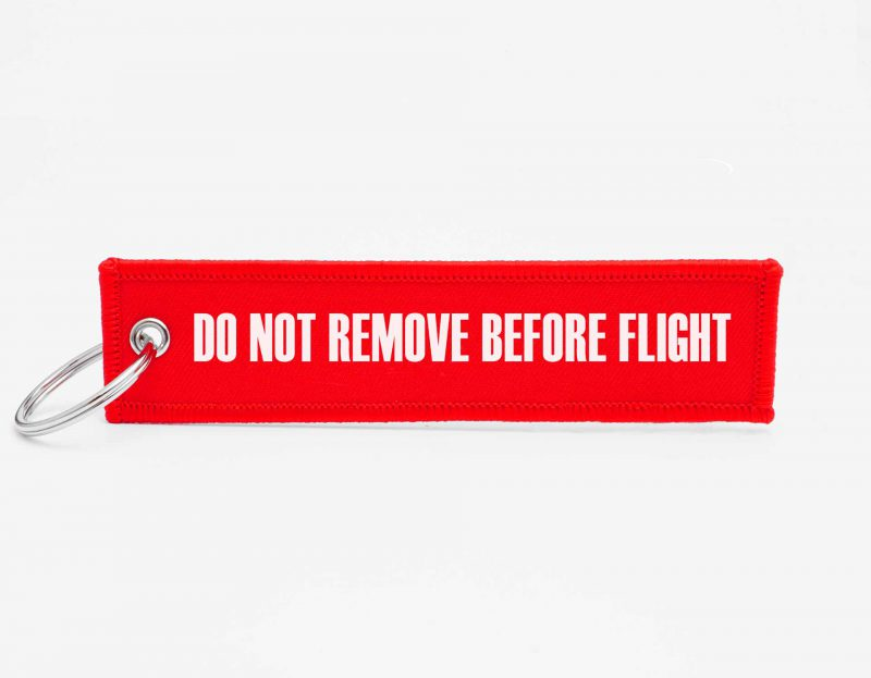 o not remove before flight Schluesselanhaenger mit logo