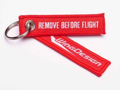 remove before flight schluesselanhaenger mit logo wingdesign