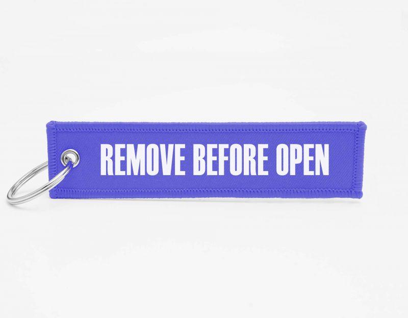 REMOVE BEFORE OPEN Schlüsselanhänger individuell mit Logo