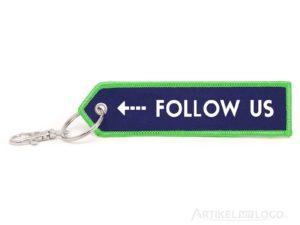 Pfeil Schlüsselanhänger mit Follow Us Motiv